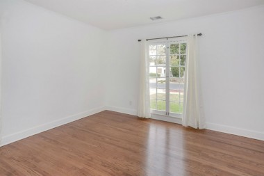 Front bedroom with newly refinished hardwood floors and spacious closet.