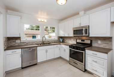 Stunning remodeled kitchen with stainless steel gas stove, built-in microwave, and dishwasher!