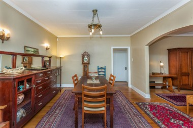 Formal dining room with original built-in sideboard.