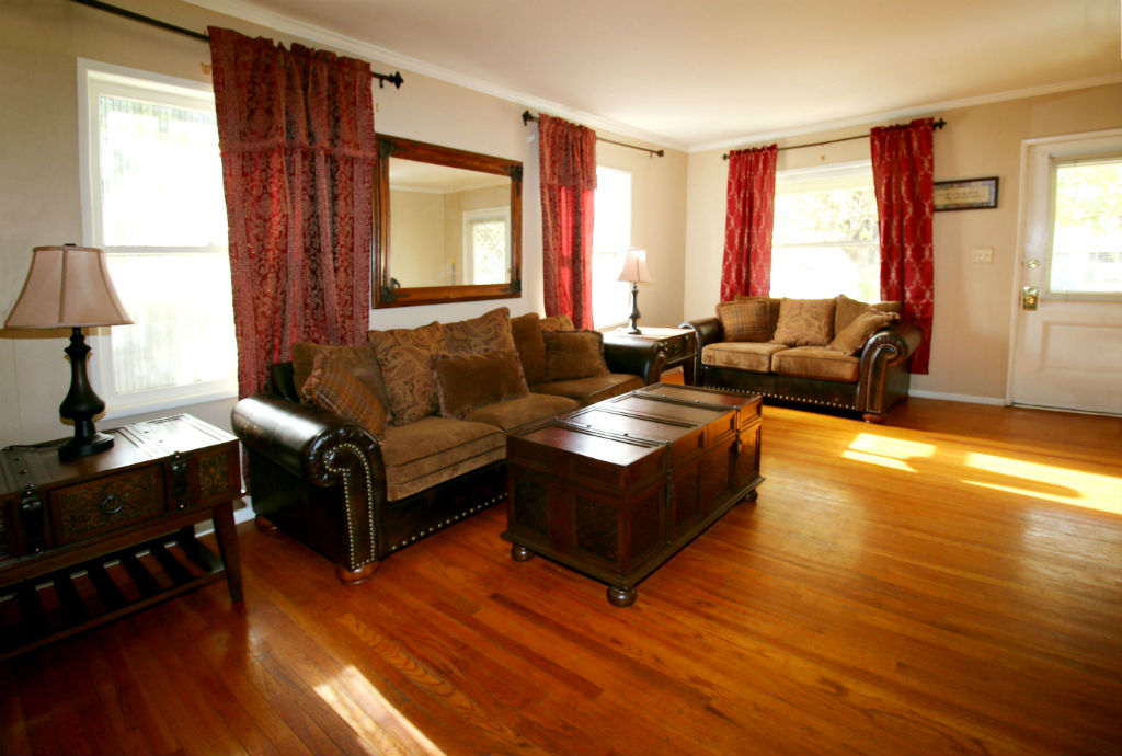 Living room with original hardwood floors.