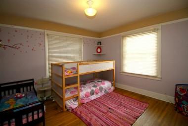 Front bedroom with original hardwood floors.