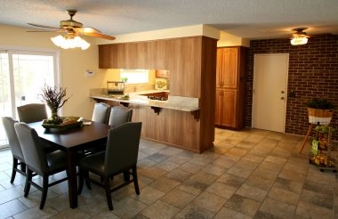 Remodeled and spacious kitchen with formal dining area, breakfast bar, granite counter tops, tile flooring, and dishwasher.