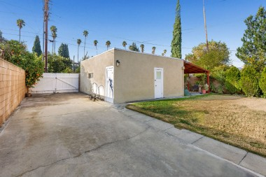 2-car detached garage, gated RV parking, a workshop, and a covered patio.