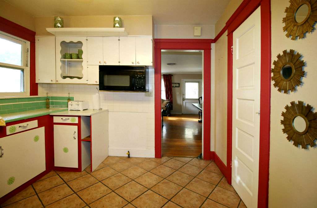 Kitchen with tile floor, two pantries (one of which is a large walk-in).