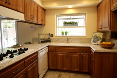 Gorgeous kitchen with recessed lighting, granite counters, garden window, and newer appliances.