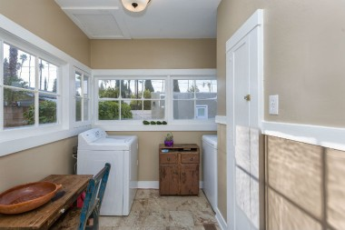 Separate indoor laundry room.