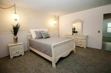 Main floor master bedroom with newer carpeting, window shutters, private bathroom, and walk-in closet!