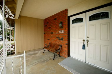 Covered front porch with double door entry