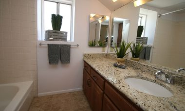 Upstairs full bathroom with tile flooring and granite counter top.