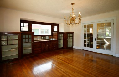 Gorgeous formal dining room with French doors to living room