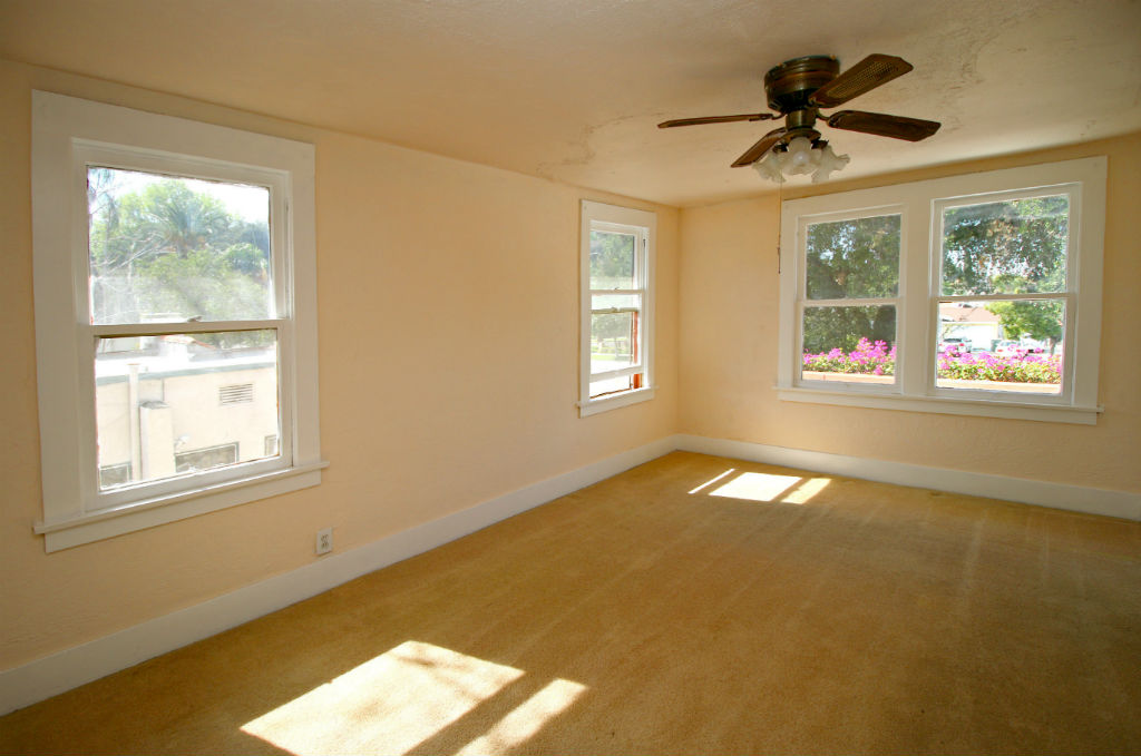 One of three upstairs bedrooms, this one with two closets and carpeting.