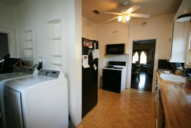 Kitchen with dishwasher, built-in microwave, walk-in pantry, and interior laundry area.