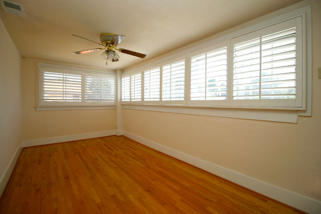 One of three upstairs bedrooms (this one has newer oak floors).