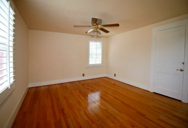 Alternate view of bedroom with newer oak wood floors.
