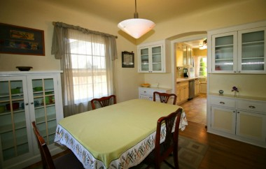 Look at this lovely formal dining room with built-in cabinetry and period light fixture.