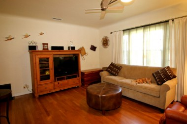 Alternate view of living room with coved ceilings and lots of natural light.