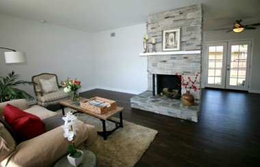 New paint, flooring, gorgeous gas and wood-burning fireplace.
