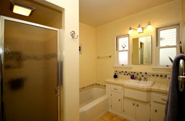 Updated retro bathroom with separate shower and tub.