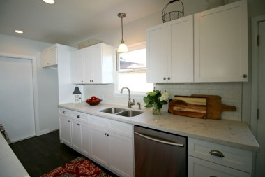 Beautifully remodeled kitchen with recessed lighting in addition to lots of natural light.