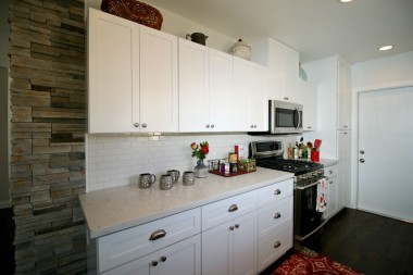Beautifully remodeled kitchen with stainless steel appliances.