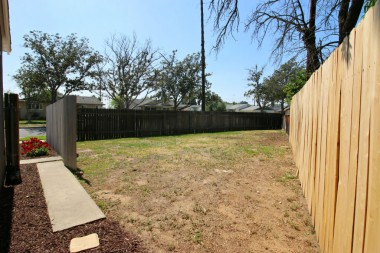 In addition to the back yard, this spacious side yard offers even more room for gardening, swing set, or even a pool.