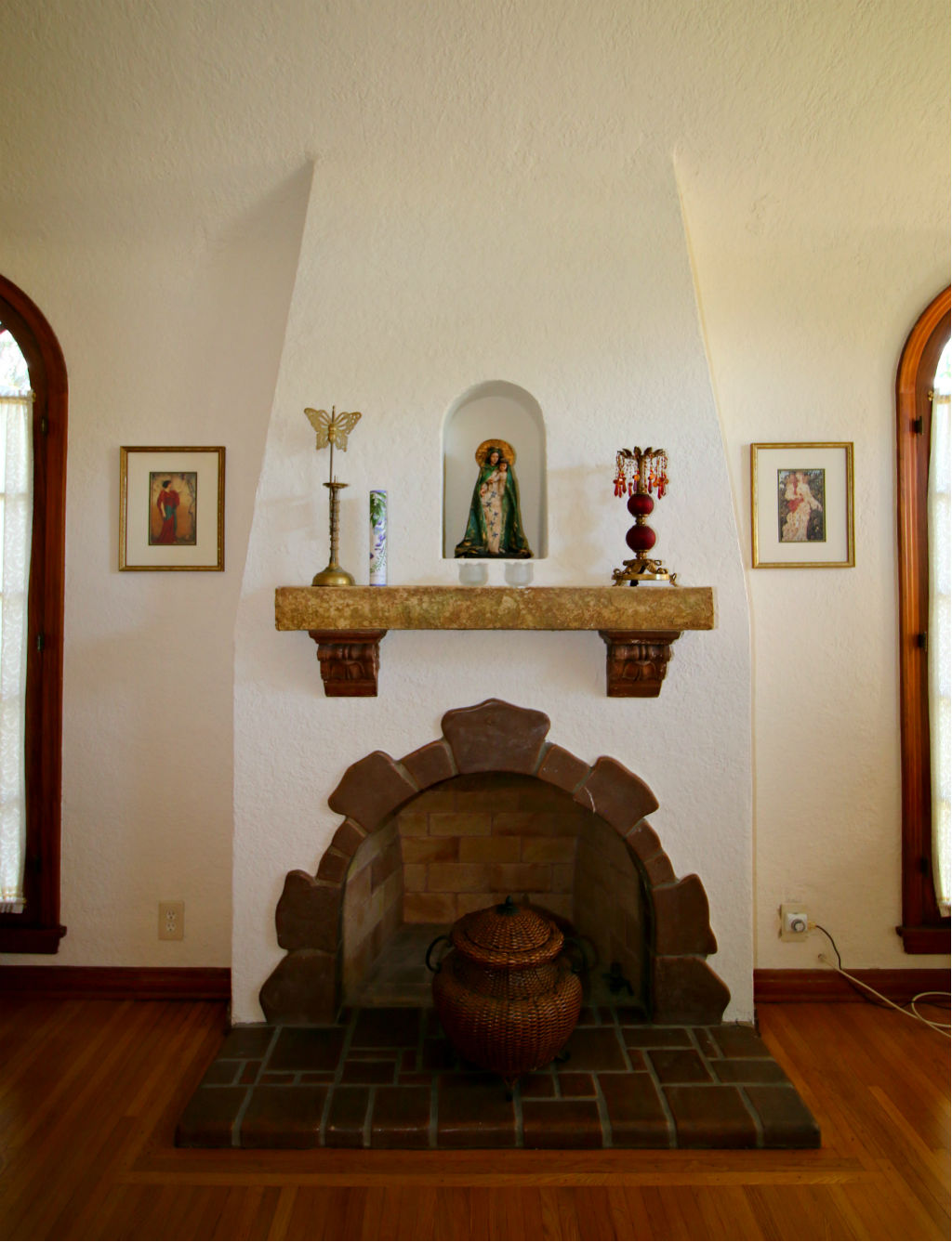 Wood-burning fireplace with alcove.