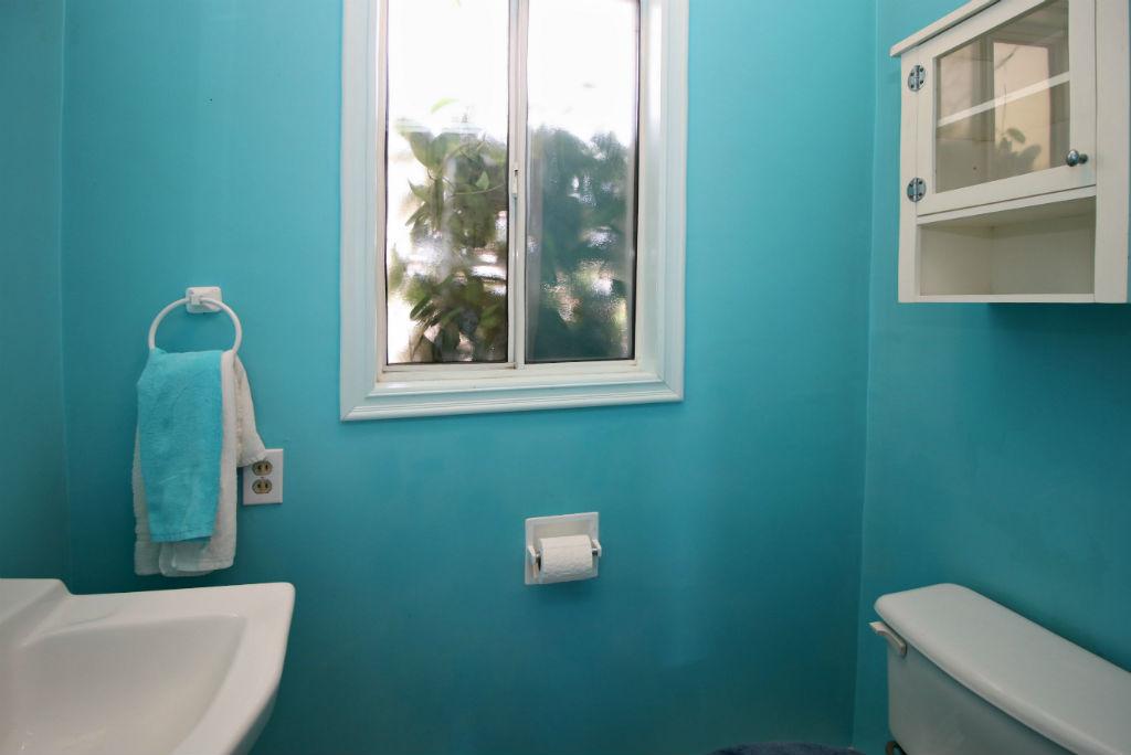 Convenient half bathroom off the laundry room.