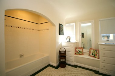 Gorgeously updated bathroom with original basket weave tile floor, original built-in drawers and seat, as well as original tub. Home has been updated with copper plumbing.