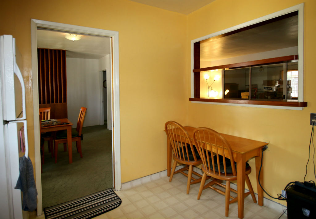 Small dining area in kitchen with pass-thru.