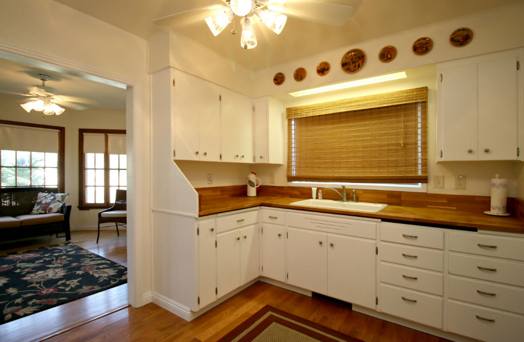 Updated kitchen with newer wood floors, adjacent to family room.