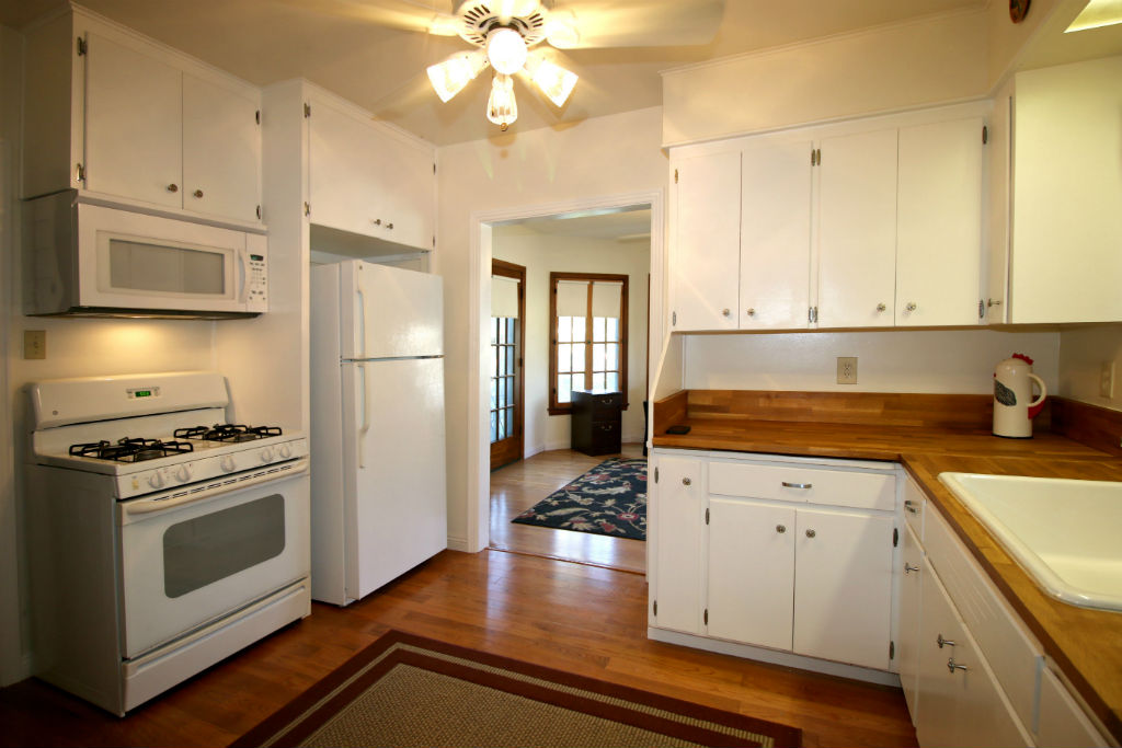 Updated kitchen with gas stove and built-in microwave with newer wood floors.