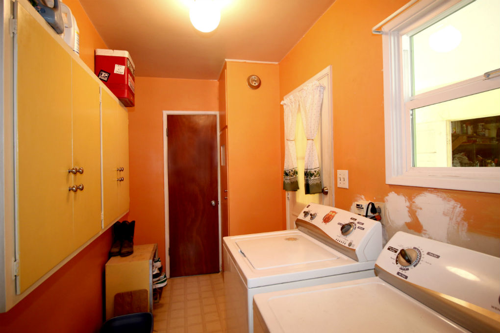 Colorful laundry room just off the kitchen.