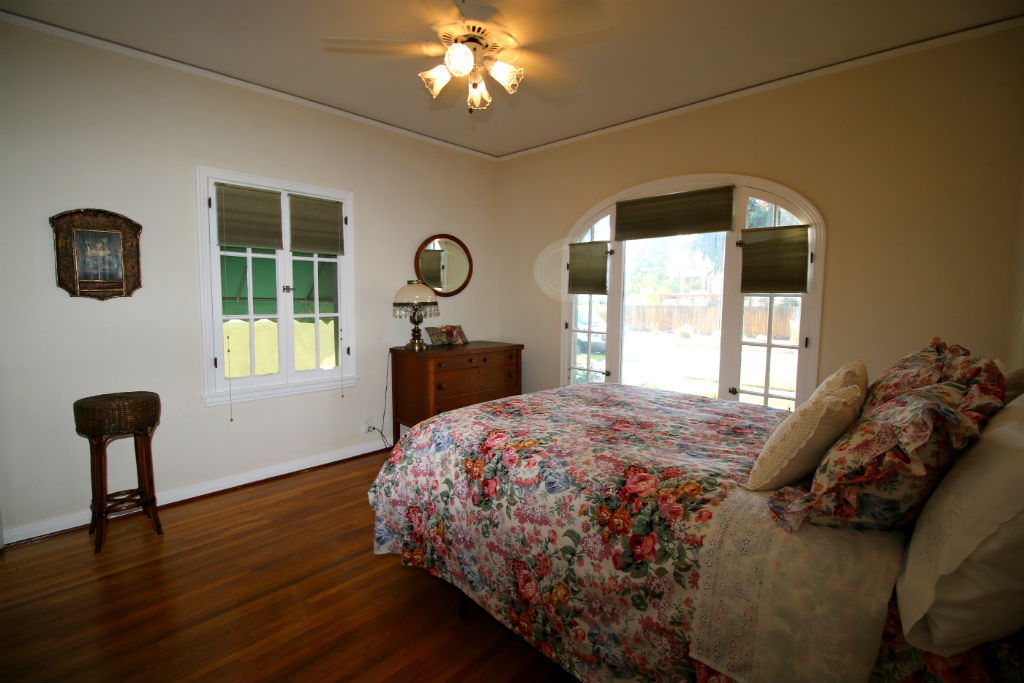 Master bedroom with original hardwood floors and walk-thru closet that leads to the spacious remodeled bathroom.