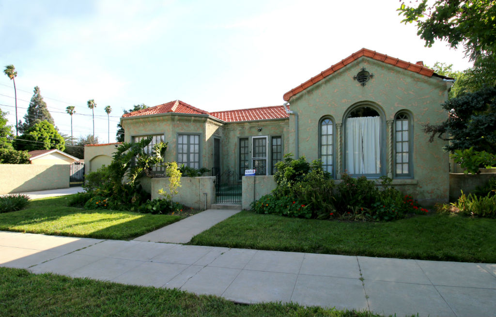 Side view of home with second courtyard, accessible from both the formal dining room and the family room.