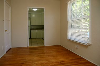 Formal dining room with lovely original hardwood floors.