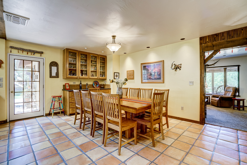 Formal Dining room with built-in hutch and bar sink, with French door leading to side patio for Al fresco dining!