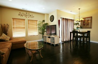 Engineered hardwood flooring (hand-scraped) throughout the living room and the formal dining area.