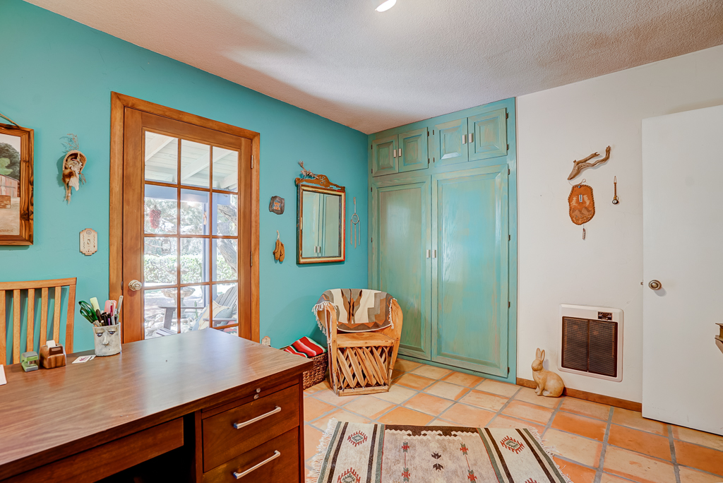 Alternate view of back bedroom with French door leading to back covered patio and the relaxing sound of a trickling fountain.