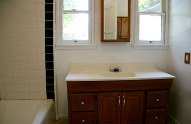 Updated bathroom with tile flooring and newer vanity.