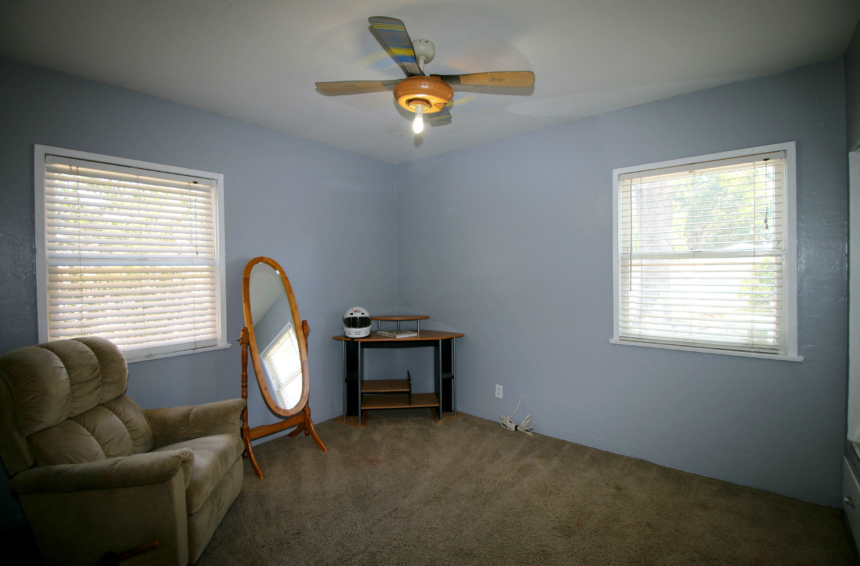 Bedroom #2 with ceiling fan and carpet.