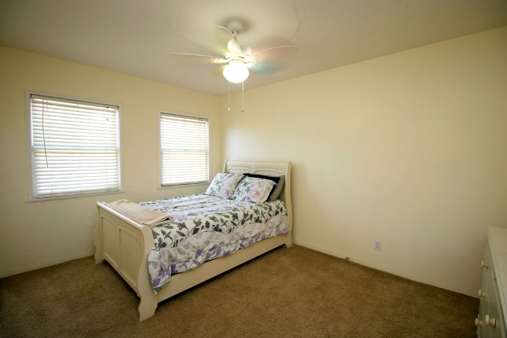 Bedroom #3 with ceiling fan and carpet.