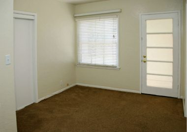 Bedroom #3 with carpeting and separate entrance. Ideal for guests or college student. This room overlooks the backyard also.