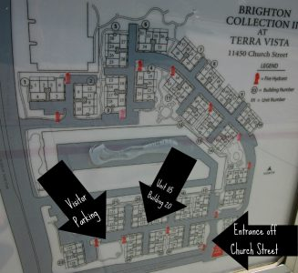 Condo complex legend displaying easy access to unit #115, as well as visitor parking.