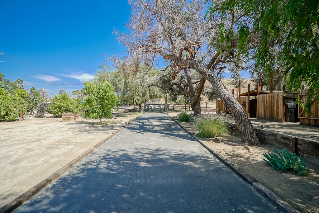 Long driveway, with electric gated entry.