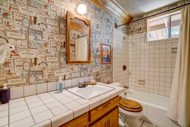 Tiled hallway bathroom shared between two bedrooms on one side of the house.