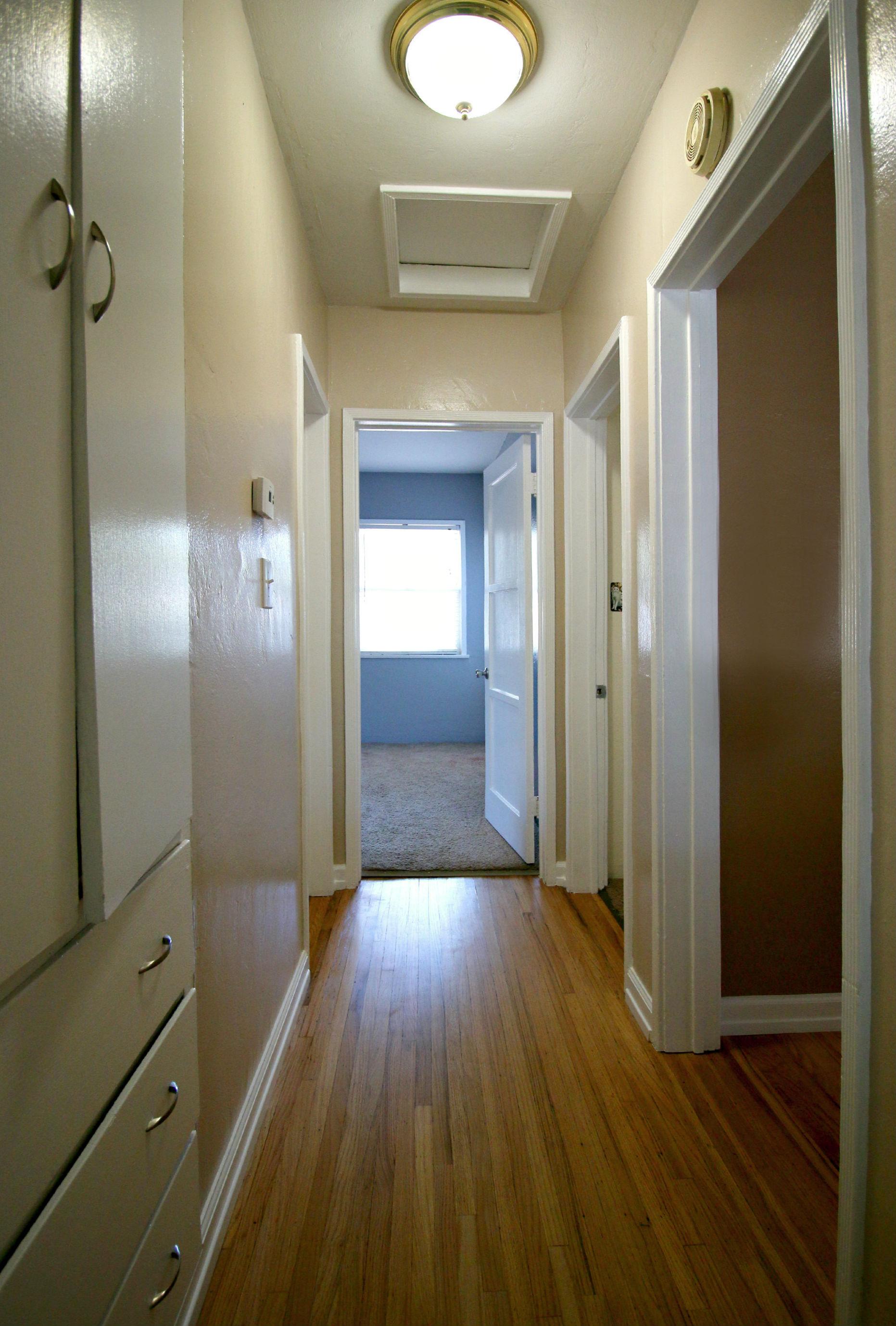 Hallway with newly refinished hardwood flooring.