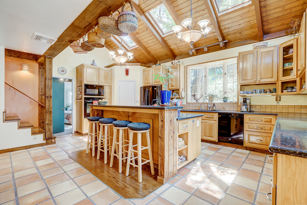 Remodeled custom chef's kitchen with skylights and endless features.