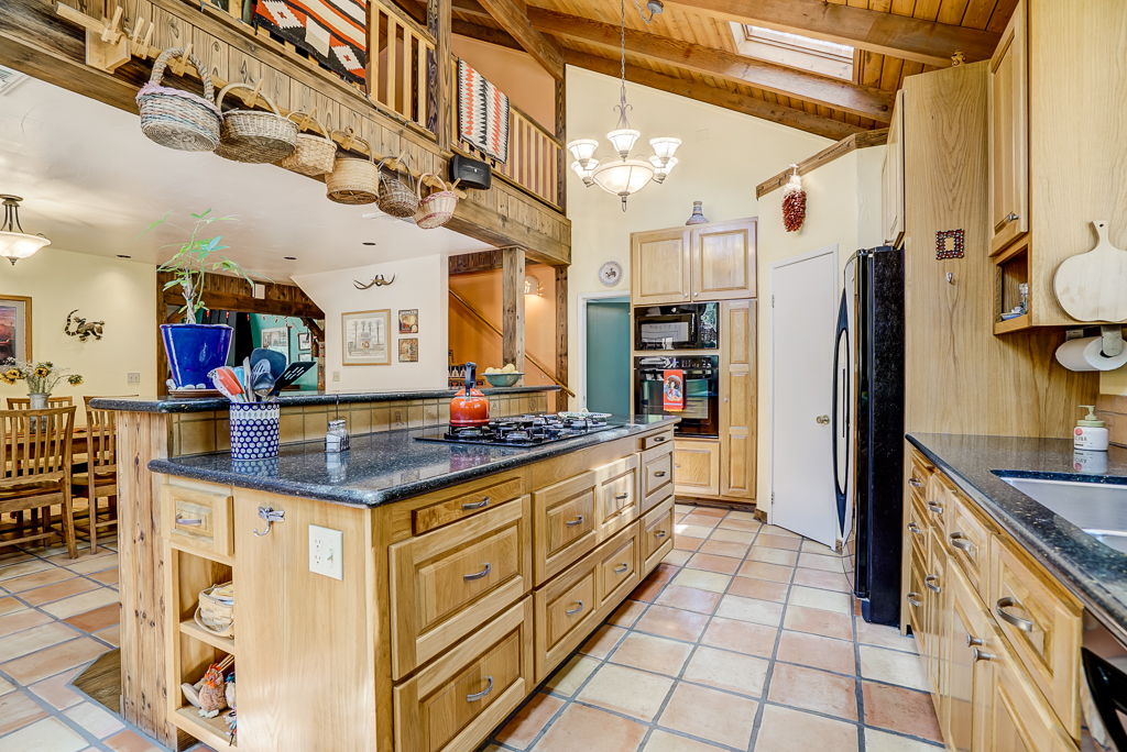 This is a true chef's kitchen with Silestone quartz counters. So many features that would make any true cooking afficionado blush with delight.