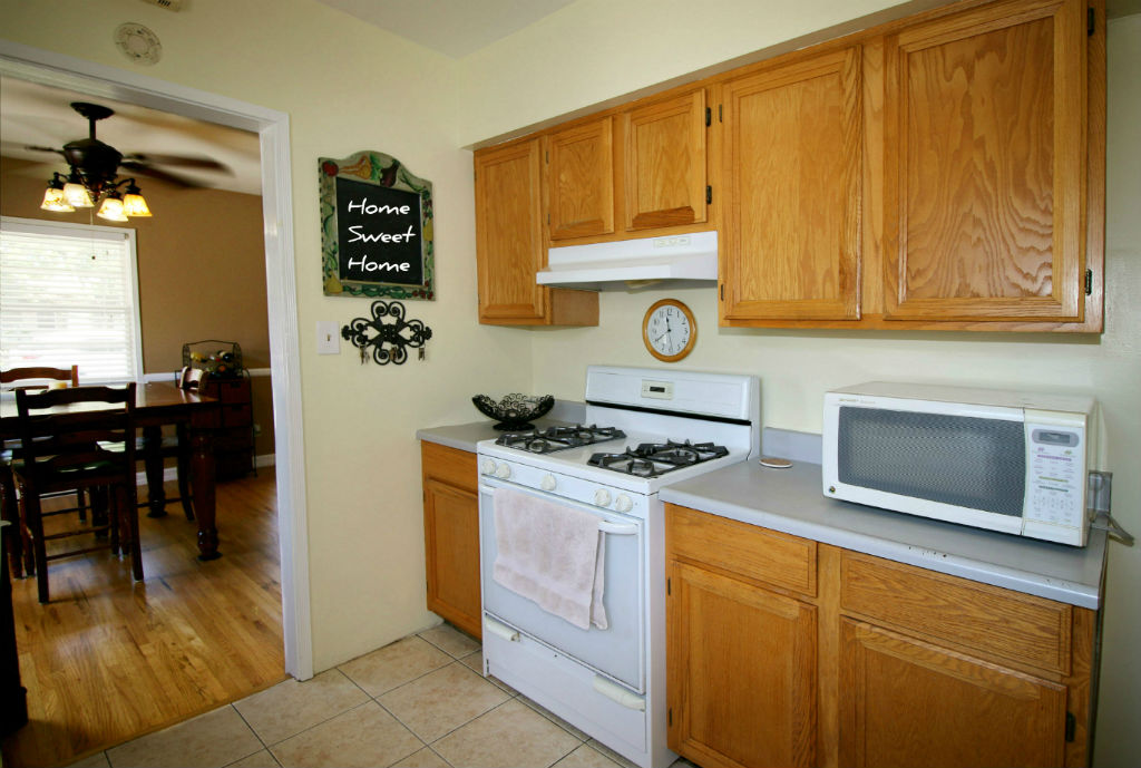 Updated kitchen with gas stove and tile flooring.