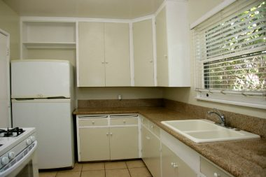 Updated kitchen with stone counter tops and tile floor. Gas stove and refrigerator are included!